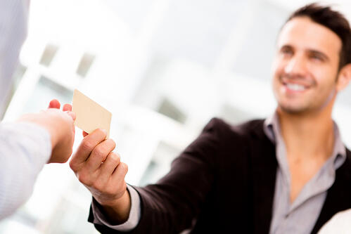 Business man paying with a credit or debit card